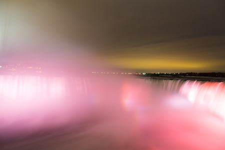 horseshoe falls: NIAGARA FALLS, CANADA - 3RD NOVEMBER 2014: Closeup to the Horseshoe Falls at night showing the lights on the Waterfall