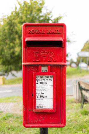 royal mail: PADBURY, ENGLAND - 23RD SEPTEMBER 2014:  A closeup to a small Royal Mail Postbox in a village Editorial