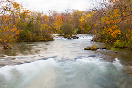 Fast flowing stream in the autumn photo