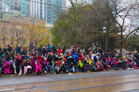TORONTO, CANADA - 16TH NOVEMBER 2014: People outside waiting for the Santa Clause Parade in Toronto