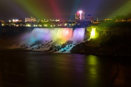 american falls: NIAGARA FALLS, CANADA - 3RD NOVEMBER 2014: Spot lights being used on the American Falls waterfall at night