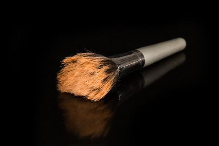 A closeup to a makeup brush
