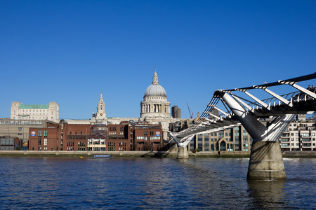 st pauls: LONDON, UK - 11TH JANUARY 2014: St Pauls Cathedral and Millennium Bridge during the day Editorial