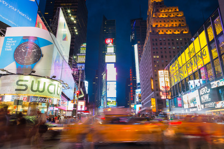 31st: NEW YORK CITY, USA - 31ST AUGUST 2014: Time Square at Dusk showing taxis going past and billboards lit up Editorial