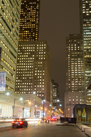 king street: TORONTO, CANADA - 9TH DECEMBER 2014: King Street in Toronto at night. Cars and office buildings can be seen Editorial
