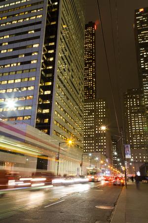king street: TORONTO, CANADA - 9TH DECEMBER 2014: King Street in Toronto at night showing the blur of traffic