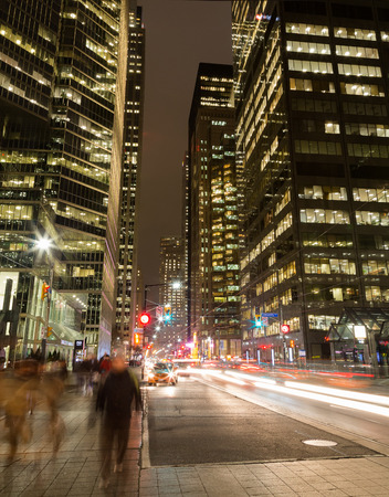 king street: TORONTO, CANADA - 9TH DECEMBER 2014: King Street in Toronto at night showing the blur of traffic and people Editorial