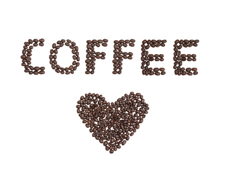 The word Coffee written with Coffee Beans and a love heart underneath Stock Photo