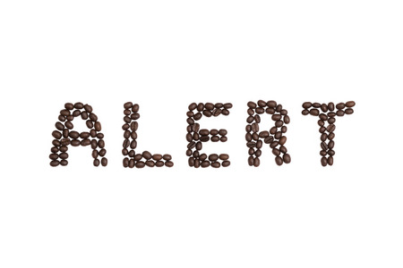 cns: The word Alert written with coffee beans Stock Photo
