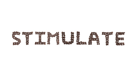 stimulate: The word STIMULATE written with coffee beans