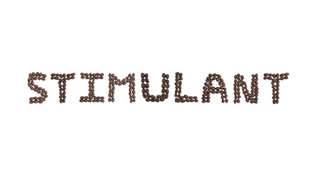 The word STIMULANT written with coffee beans