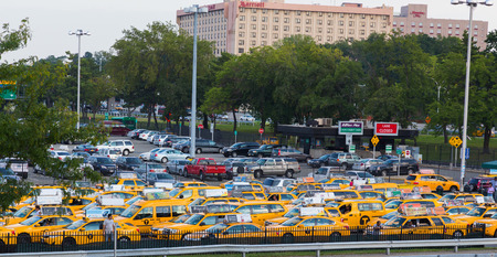 NEW YORK CITY, USA - 1ST SEPTEMBER 2014: Large amounts of New York City Taxis parked up waiting near the airport
