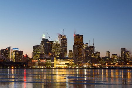 td: TORONTO, CANADA - 16TH JANUARY 2015: Buildings in downtown Toronto at night in the winter showing many office buildings and reflections in the ice