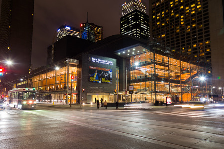 TORONTO, CANADA - 21ST JANUARY 2015: The outside of the Four Seasons Centre For The Performing Arts at night. Traffic and people can be seen.