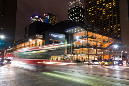 toronto: TORONTO, CANADA - 21ST JANUARY 2015: The outside of the Four Seasons Centre For The Performing Arts at night. Traffic and people can be seen. Editorial
