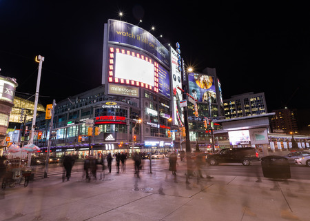 TORONTO, CANADA - 22ND JANUARY 2015: Yonge Dundas Square at night showing the blur of people and buildings