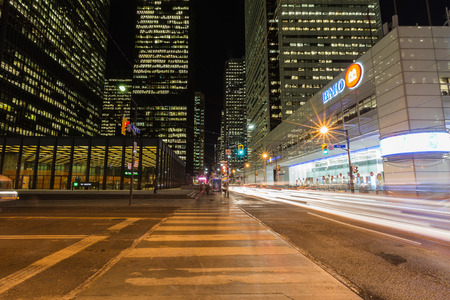 king street: TORONTO, CANADA - 22ND JANUARY 2015: Buildings in downtown Toronto along King Street. The blur of traffic can be seen