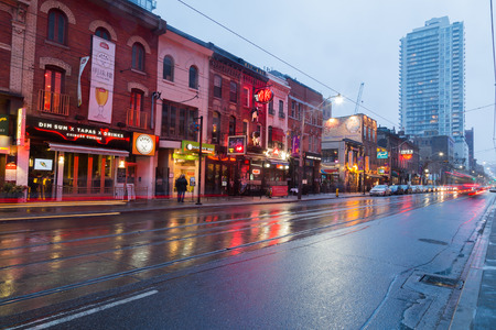 king street: TORONTO, CANADA - 24TH JANUARY 2015: Buildings along King Street East at twlight showing various buildings Editorial