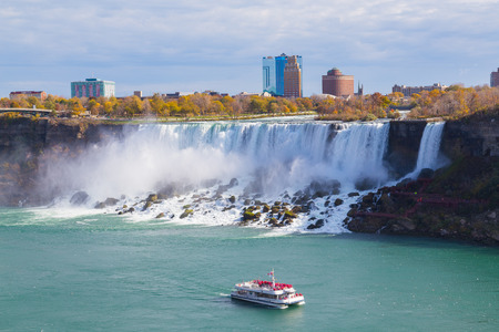 american falls: NIAGARA FALLS, CANADA - 3RD NOVEMBER 2014: A view of the Hornblower Boat with people on it in front of the American Falls Editorial