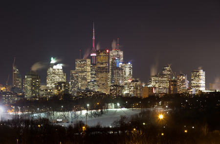 building cn tower: Downtown Toronto at Night in the Winter. Snow can be seen