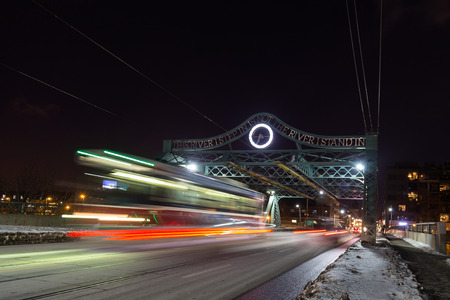 streetcar: A bridge in East Toronto with the blur of a Streetcar at night