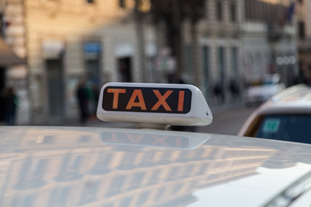 taxi sign: Taxi Sign on a Taxi in Rome