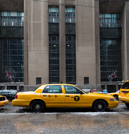 taxi: TORONTO, CANADA - 22ND FEBRUARY 2015: A New York City Taxi in downtown Toronto during the day.