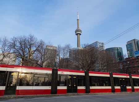 streetcar: TORONTO, CANADA - 26TH FEBRUARY 2015: NEw Streetcar in Toronto with the CN Tower in the Background