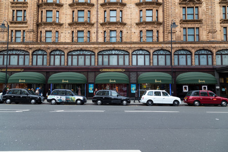 knightsbridge: LONDON, UK - 9TH MARCH 2015: Various coloured taxis in central London outside Harrods