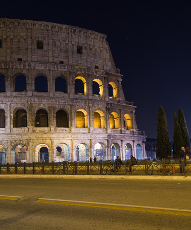 17th of march: ROME- ITALY - 17TH MARCH 2015: The Colosseum in Rome at Dusk. The blur of people can be seen