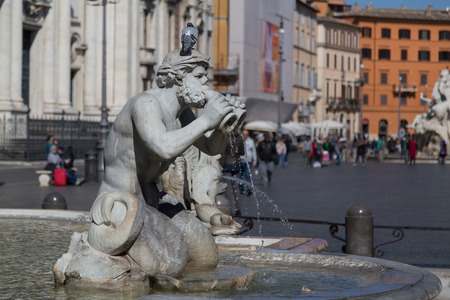 navona: A fountain at Piazza Navona Rome. The blur of people can be seen in the background Editorial