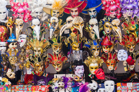 guy fawkes mask: VENICE, ITALY - 15TH MARCH 2015: Large amounts of Venetian Masks on display on a market stand
