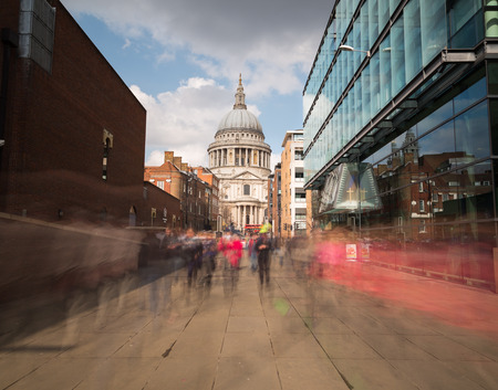 st pauls: LONDON, UK - 25TH MARCH 2015:  A view towards St PAuls Cathedral in London during the day. Showing the blur of people walking past