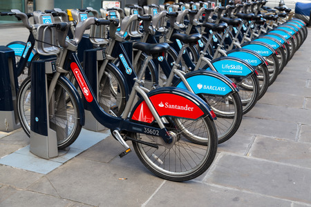 sponsorship: LONDON, UK - 25TH MARCH 2015:  A Santander public hire bike along with Barclays Bikes locked at the docking bays Editorial