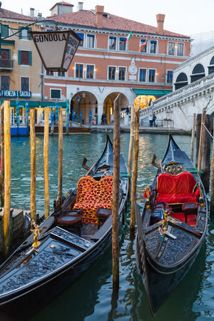 waterside: VENICE, ITALY - 14TH MARCH 2015: Typical Gondolas docked at the waterside in Venice. Editorial