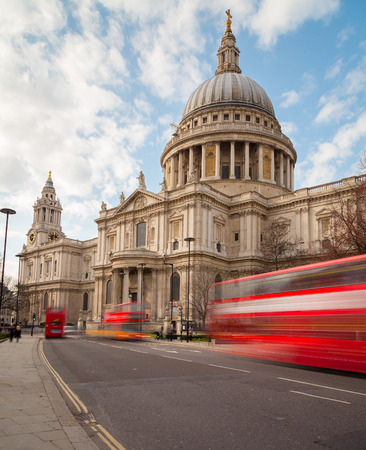 during the day: St Pauls Cathedral and Traffic during the day showing double decker buses on the road Stock Photo