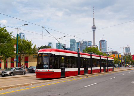 september 9th: TORONTO, CANADA - 9TH SEPTEMBER 2014: A view of the new Toronto Street Cars during the day. Passengers can be seen on the vehicle
