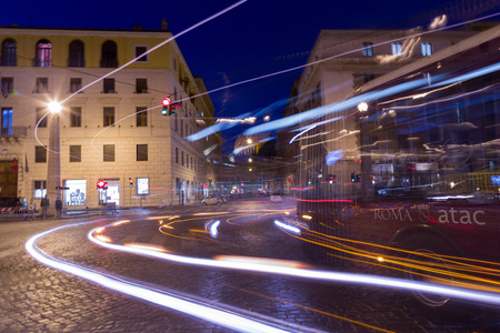 crowded space: ROME, ITALY - 12TH MARCH 2015: Traffic in Rome during the day showing a local bus on the road and the blur of traffic. People can be seen on the street.