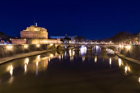 pons: Castel SantAngelo (Castle of the Holy Angel) and Ponte SantAngelo bridge at night.