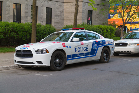 Police car: A closeup to a Police Car in Montreal Editorial
