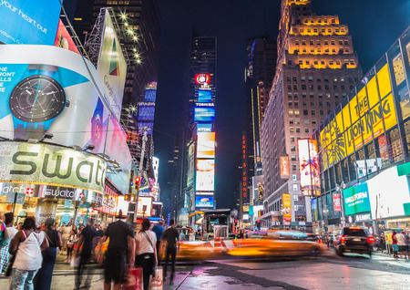 square: NEW YORK CITY, USA - 31ST AUGUST 2014: Time Square at Dusk showing taxis going past and billboards lit up Editorial