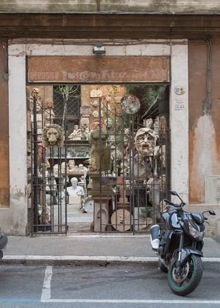 engravings: ROME, ITALY - 11TH MARCH 2015: The outside of a shop selling stone ornaments and engravings in Rome