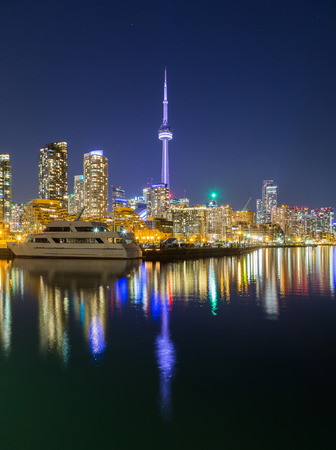 building cn tower: TORONTO, CANADA - 16TH APRIL 2015: A view of Toronto downtown at dusk showing buildings, condos, the CN Tower and boats.