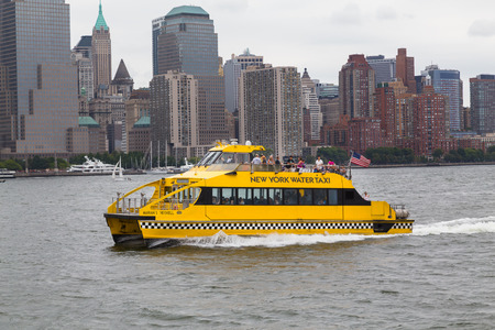 lots people: NEW YORK CITY, USA - 30TH AUGUST 2014: A New York Water Taxi boat in the Hudson River with lots of people on board