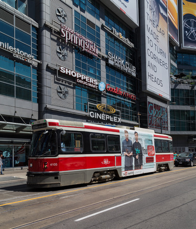 streetcar: TORONTO, CANADA - 23RD MAY 2015: A Toronto Streetcar at Yonge and Dundas Square in downtown Toronto during the day. People can be seen. Editorial