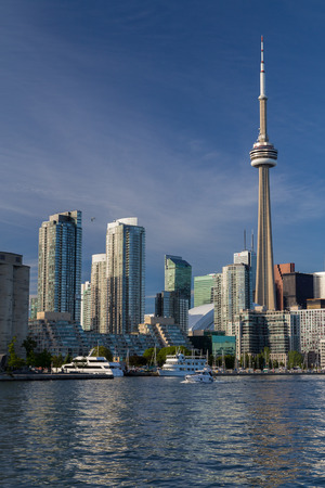 building cn tower: TORONTO, CANADA - 7TH JUNE 2015: The CN Tower, condos, office buildings in Toronto along the waterfront. Boats can also be seen.