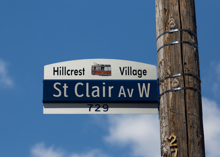 clair: TORONTO, CANADA - 2ND JUNE 2015: A closeup to a sign for St Clair Avenue West in the Hillcrest Village area of Toronto Editorial