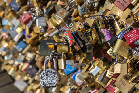declaring: PARIS, FRANCE - 20TH MARCH 2014: A closeup to the padlocks on Pont des Arts bridge in Paris during the day Editorial