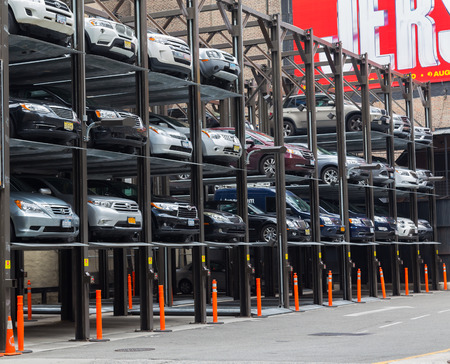 new car lots: NEW YORK CITY, USA - 31ST AUGUST 2014: A typical Car Park down a street in New York City