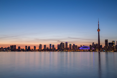 building cn tower: A view of buildings West of Downtown at dusk from Lake Ontario with copy space above or below the buildings Stock Photo